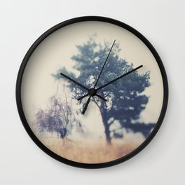 the story ... a tree & a field clouded in morning fog Wall Clock