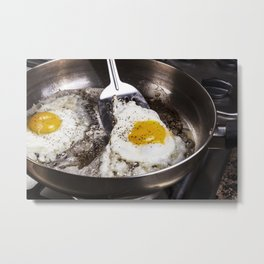 Eggs cooked with bacon grease in pan Metal Print