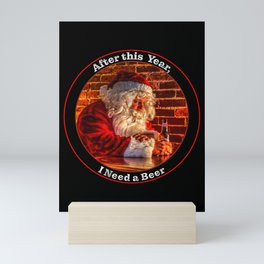 After this year, Santa needs to relax while Checking the Naughty or Nice List Mini Art Print