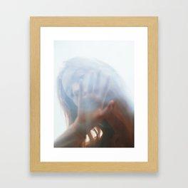 Woman through glass Framed Art Print