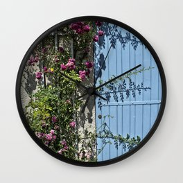 Blue door pink flowers - Provence, France Wall Clock