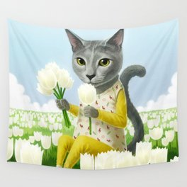 A cat sitting in the flower garden Wall Tapestry