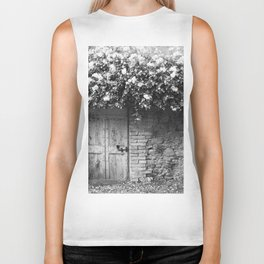 Old Italian wall overgrown with roses Biker Tank