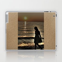 Sunset and lonely silhouette on the beach Laptop & iPad Skin
