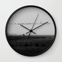 birds on wires in the still of the morning fog ... Wall Clock