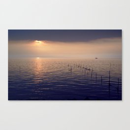sunset lake with boat Canvas Print