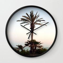 Palm tree on the beach Wall Clock