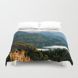 Castle under mountains Duvet Cover