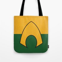 dc comics Tote Bags featuring Aquaman Logo Minimalist Art Print DC Comics by The Retro Inc