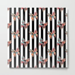 Creative , colorful butterfly of an black and white striped background . Metal Print