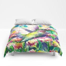 Hummingbird in flowers Comforters