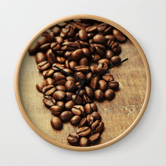Coffee beans on wooden background Wall Clock