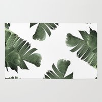 banana leaf Area & Throw Rugs featuring Banana Leaf Frenzy #society6 by 83 Oranges™