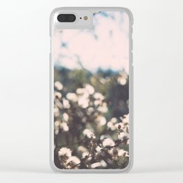 Faded white flowers on the side of a mountain Clear iPhone Case