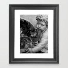 The Haunted Cherub. Framed Art Print