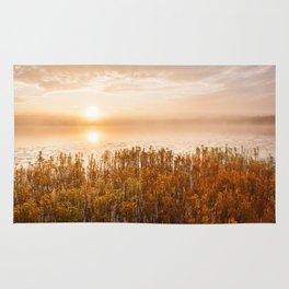 Sunrise at foggy serene lake Rug