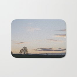 Tree on a hilltop above Matlock silhouetted at twilight. Derbyshire, UK. Bath Mat