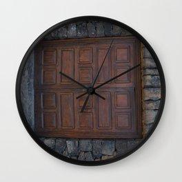 Old doors in a lava brick building Wall Clock