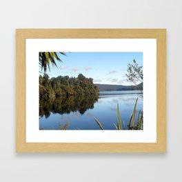 Morning skies over lake Framed Art Print