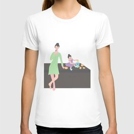 daughter squeezes out the juice of oranges for mom. little girl sitting on the table near the juicer. woman stands T-shirt