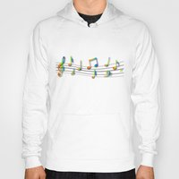 music notes Hoodies featuring Rainbow Music Notes on Black by GBC Design