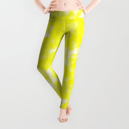 A bright cluster of yellow bodies on a light background. Leggings