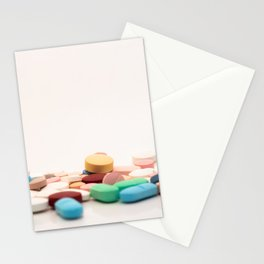 Numerous medicines Medications in the form of tablets. Colored pills on a white background. Stationery Cards