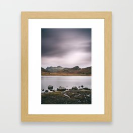 Clouds over Blea Tarn with Langdale Pikes beyond. Lake District, UK. Framed Art Print