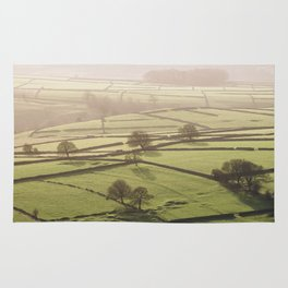 Hazy light at sunset over a valley of fields. Derbyshire, UK. Rug