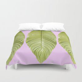 Three large green leaves on a pink background - vivid colors Duvet Cover