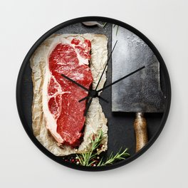 vintage cleaver and raw beef steak on dark background Wall Clock