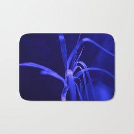 Blue plant in Luminescence light Bath Mat