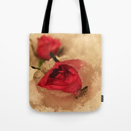 Frozen roses in the snow Tote Bag