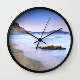 Plomo beach at sunset Wall Clock