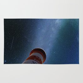 Lighthouse under starry sky Rug