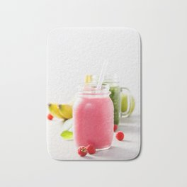 Close-up of pink fresh smoothie with fruits and berries selective focus. Bath Mat