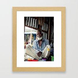 Old man in his tea shop Framed Art Print