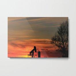 Kansas Sunset with an Oil Well pump silhouette Metal Print