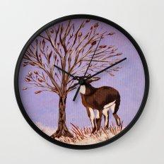 Deer by the tree Wall Clock