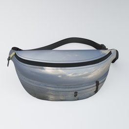 Dog walking on Caswell beach in winter Fanny Pack