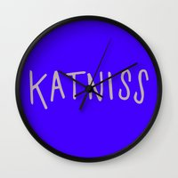 katniss Wall Clocks featuring Katniss by Annie Claire
