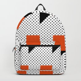 A lot of orange 3d Commas, planted in a carpet with black dots. Backpack