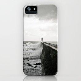 Waves break against an English pier iPhone Case