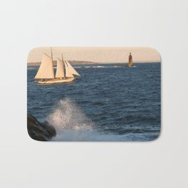 A ship, a wave and a lighthouse Bath Mat