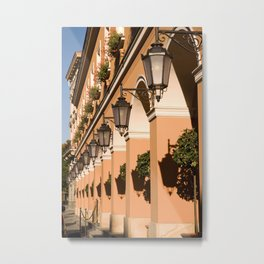 Row of lamps on columns of building Metal Print