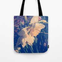 rileigh smirl Tote Bags featuring Daffodil by Rileigh Smirl