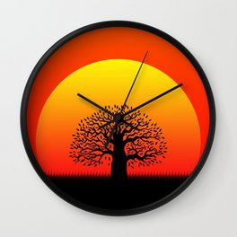 Sunset and tree of life in the savannah Wall Clock