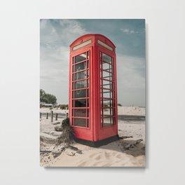 Vintage red telephone box on a sandy beach Metal Print
