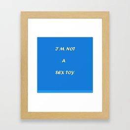 I'm not a sex toy Framed Art Print