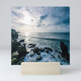 Dusky sky with sea rocks  Mini Art Print
